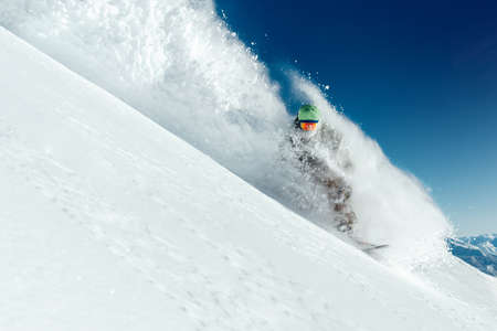 man snowboarder is going very fast  freeride in the stream of snow avalanche Фото со стока