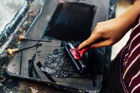 linocut. rolling paint on a piece