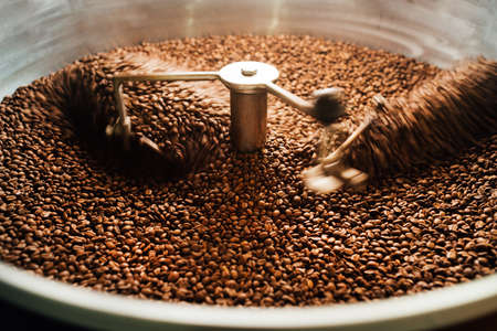 beans in a moving coffee cooling mixer of roasting machine