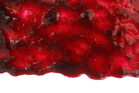 Track of  raspberry jam isolated on white background. Splashes and spilled blackberry sauce. Blots of bramble jam dipped in sauce. isolated on white background. flat lay top view.