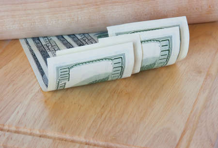 U.S. dollars are on the cutting board photo