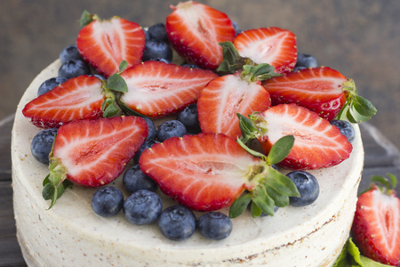 Dietary cake with berries on a wooden tray. Delicious, useful. Minimum calories  Stock Photo