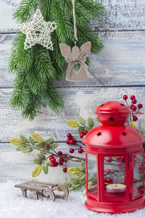 New Year card. Red candlestick and sprig Christmas tree. The theme of the new year and Christmas