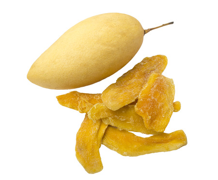 Fresh yellow mango and slices of dried mango on a white background. Isolated object
