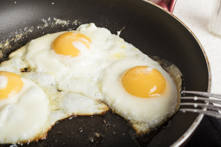 Fried eggs fried in a frying pan. Hot appetizing dish 1 Stock Photo