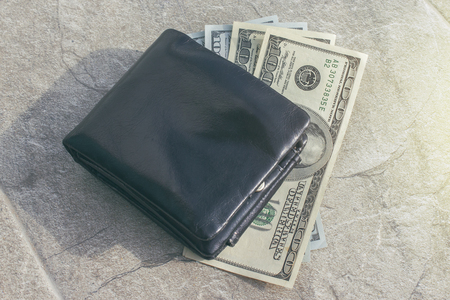 Money and a purse lie on the street. The find. View from above 1
