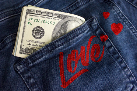 Love of money. A pack of dollars in a jeans pocket 1