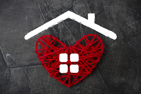 Red heart with a roof and windows in the shape of a house. Theme of housing. Mortgage, credit