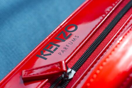 Russia, Novosibirsk - January 13, 2018 - KENZO red bag for cosmetology and perfume. Fashion accessory Editorial