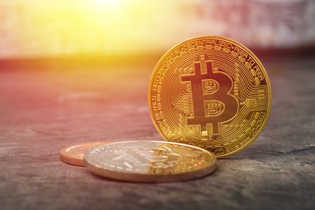 Bitcoins on a dark table. New Virtual Money Stock Photo