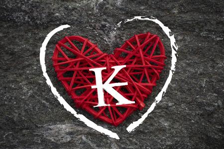 Love of money. Lao kip symbol on a red heart. Love theme 스톡 콘텐츠