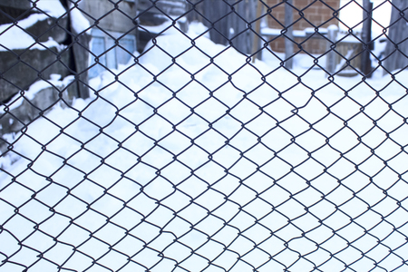 Protective mesh. Wire mesh on the shed. Background