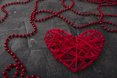 Decoration and red heart on a dark background. Space for text