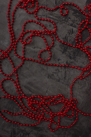 Red ornament on a dark background. Space for text
