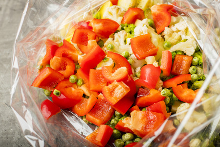Vegetarian dish. Mixed vegetables in a bag for baking in an oven. A set of vitamins 1