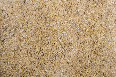 Shredded wheat, fodder for livestock. Texture, background. Close-up