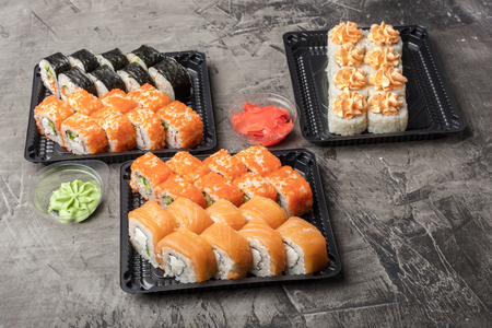 Set of Japanese rolls on a black plate. Traditional food in Japan