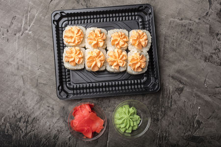 Japanese rolls lie on a black plate. Traditional food in Japan. View from above Reklamní fotografie