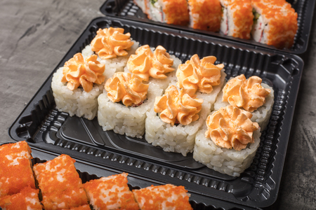 Set of Japanese rolls on a black plate. Traditional food in Japan Stock Photo - 124399585