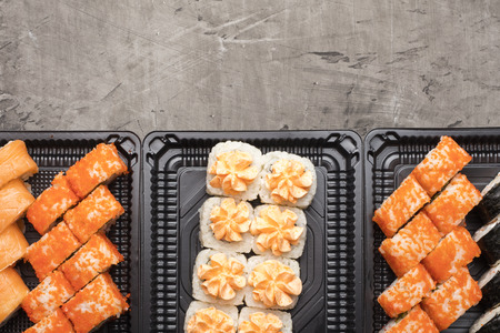 Set of Japanese rolls on a black plate. Traditional food in Japan wasabi. View from above. Copy space Stock Photo - 124399646