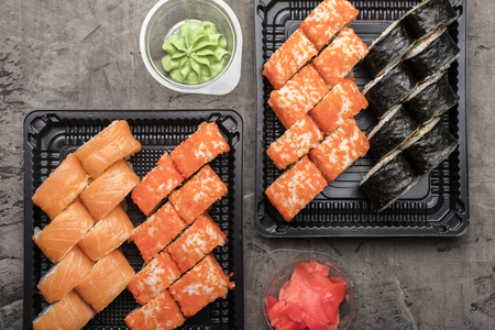 Set of Japanese rolls on a black plate. Traditional food in Japan wasabi. View from above Stock Photo