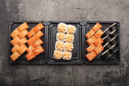 Set of Japanese rolls on a black plate. Traditional food in Japan wasabi. View from above Stock Photo - 124399874