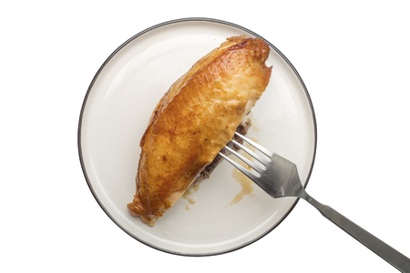 Fried chicken breast on a white plate. Isolated object 写真素材 - 124399889