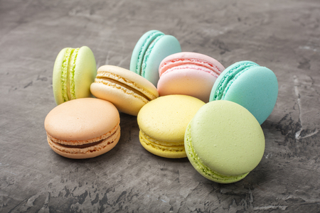 Sweet colorful macarons, on dark background Stock Photo