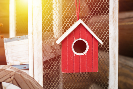 Red, wooden birdhouse. House for birds