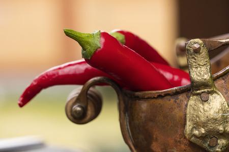 Bitter, fresh pepper, closeup on a wet table