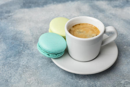 Macarons cookies with fragrant coffee. Light background