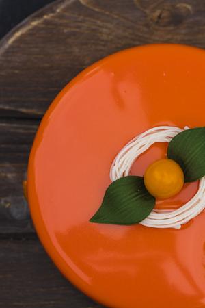 Orange cake in a mirror glaze, top view