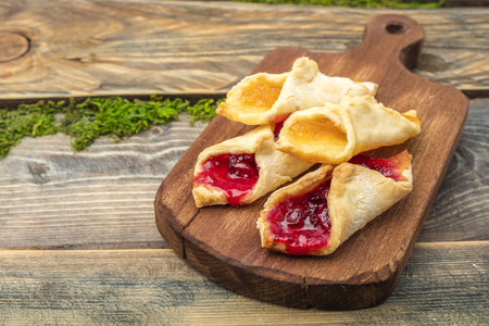 Homemade cookies with jam, on a cutting board. Wooden background Stock Photo