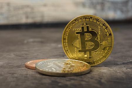 Bitcoins on a dark table. New Virtual Money