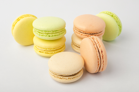 Sweet colorful cookies macarons, on a Light background