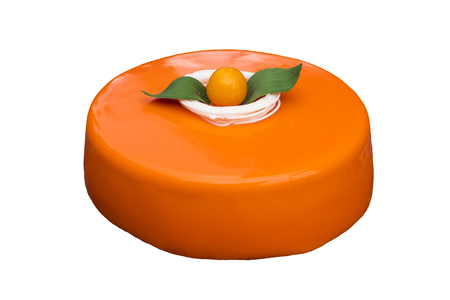 Cake with orange mousse and almond crockant in a mirror glaze, on a white background. Isolated object