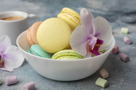 Macarons in the plate. Airy marshmallows. Light background