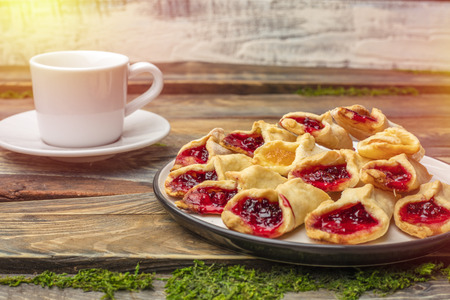 Homemade cookies with jam, on a plate. Wooden background Stock Photo