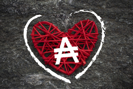 Love of money. Argentina Austral symbol on a red heart. Love theme 스톡 콘텐츠