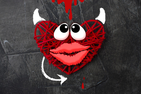 Red heart with a horn and tail of the devil Theme for Valentines Day. Wedding, love