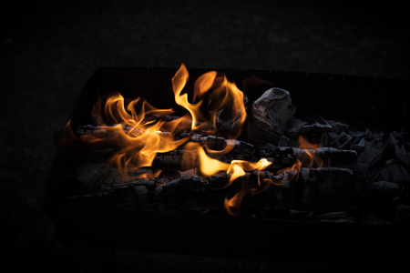 fiery flame on a black background with copy space. Background, texture