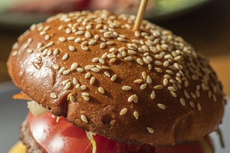 Sesame seeds on a hamburger, close-up