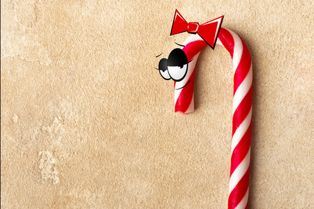 Christmas Candy Canes with eyes and a red ribbon on the head. Copy space Foto de archivo