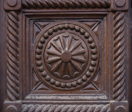 detail, carved wooden surface of an old door, background, texture