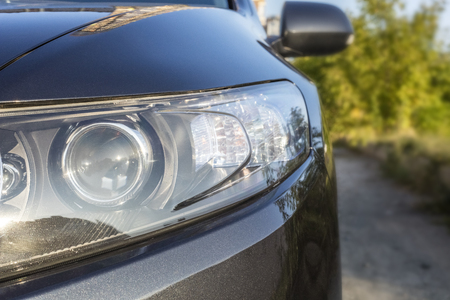 Car headlights. Exterior detail. Copy space