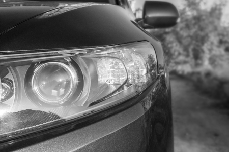 Car headlights. black and white toning. Copy space Banco de Imagens