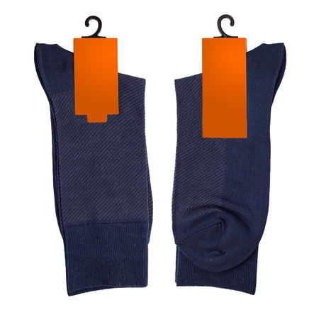 New socks on a white background. Blue socks with orange label. isolated object