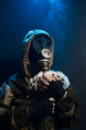 the photo of girl in gas mask on grey background c daisies