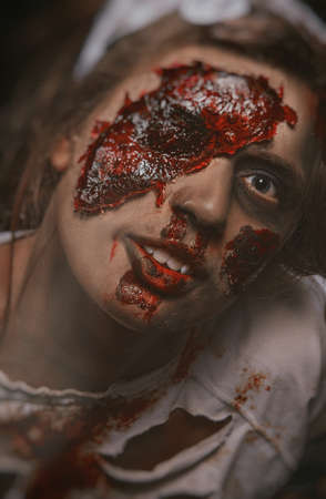 photo of the girl in zombie makeup covered in blood Stock fotó