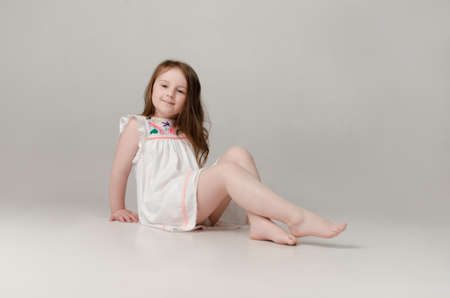 child in the Studio posing in fashionable clothes